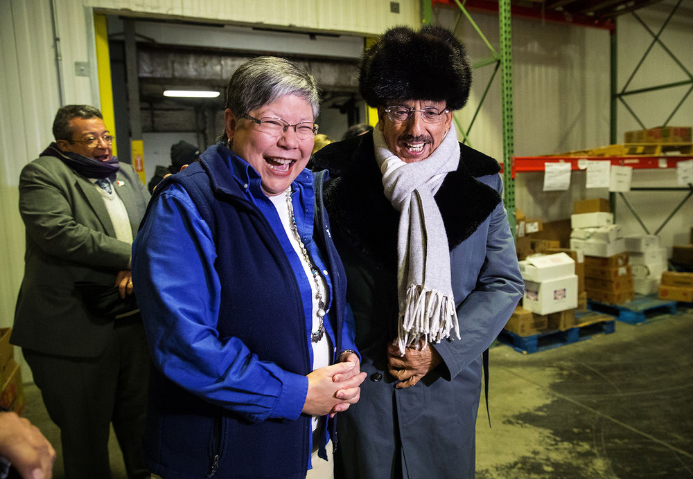 Pam Molitoris, executive director of the Central Illinois Foodbank, laughs with Khalaf Al Habtoor after he donned his winter coat, hat and scarf to tour the deep freezer at the foodbank during a tour of the facility Thursday, Feb. 8, 2018. Molitoris explained that the temperature in the freezer is kept at 10 degrees below 0, well below the 57 degree average low February temperature in the United Arab Emirates where Al Habtoor calls home. Al Habtoor was in town to announce a $500,000 contribution, over a five-year period, from the Al Habtoor Group of Dubai, United Arab Emirates to the foodbank. The Dr. Khalaf Al Habtoor and Congressman Paul Findley's Children Fund will be used to establish an endowment to fund programs that provide food to people in need throughout the foodbank's 21-county region. [Ted Schurter/The State Journal-Register]