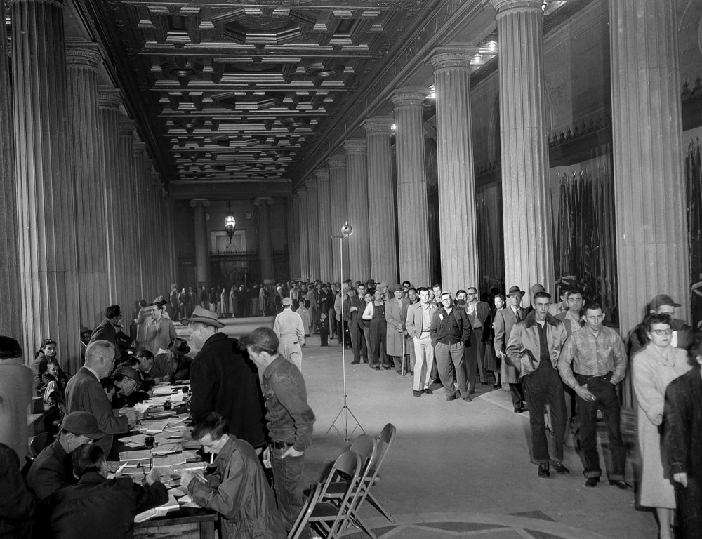 Centennial Building (Howlett Building), Hall of Flags, people in line to get license plates, Feb.15, 1957. File/The State Journal-Register