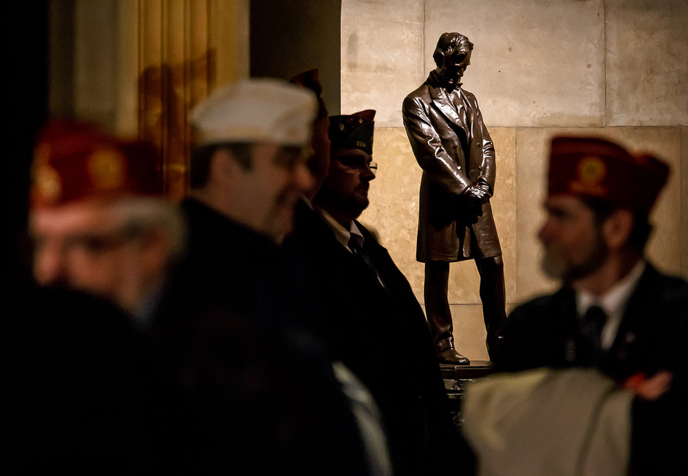"The hallways of Lincoln's Tomb were lined with people next to the ""Standing Lincoln"" statue by Daniel Chester French listening to the ceremony during the 84th Annual National American Legion Pilgrimage to the Tomb of Abraham Lincoln in celebration of Lincoln's 209th birthday at Oak Ridge Cemetery, Monday, Feb. 12, 2018, in Springfield, Ill. American Legion officials from the national, state and local level and various groups attend the event which is longest, continuously running Lincoln birthday celebration in the United States. [Justin L. Fowler/The State Journal-Register]"