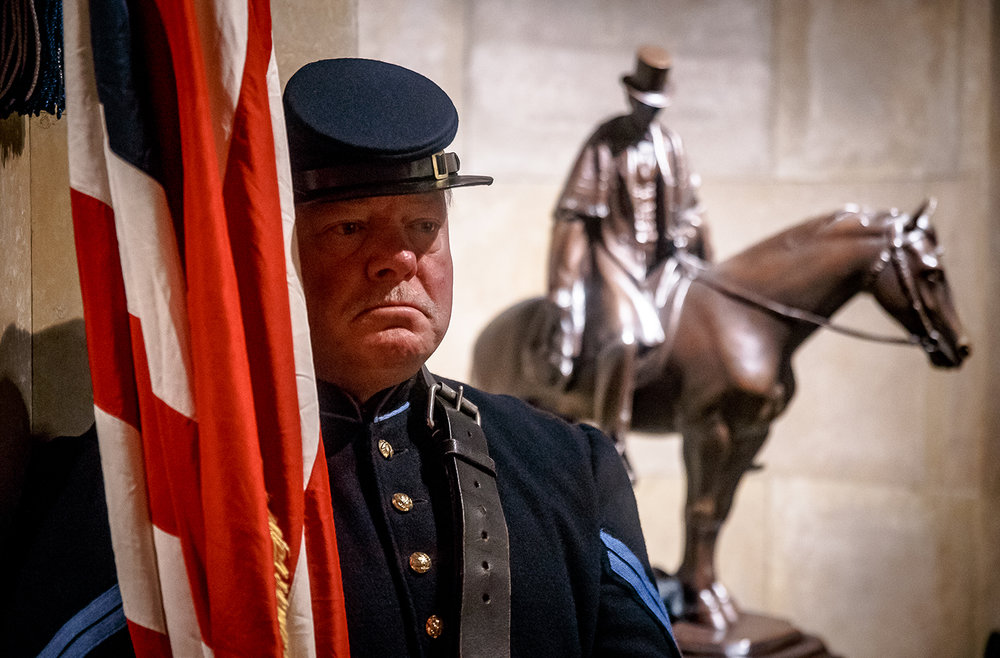 Stan Buckles of the 114th Illinois Volunteer Infantry Regiment Re- Activated stands at rest as he watches over the American Flag during the 84th Annual National American Legion Pilgrimage to the Tomb of Abraham Lincoln in celebration of Lincoln's 209th birthday at Oak Ridge Cemetery, Monday, Feb. 12, 2018, in Springfield, Ill. American Legion officials from the national, state and local level and various groups attend the event which is longest, continuously running Lincoln birthday celebration in the United States. [Justin L. Fowler/The State Journal-Register]
