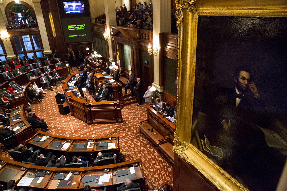 An oil painting of Abraham Lincoln hangs over the Republican side of the House Chamber where Gov.Bruce Rauner delivers his budget address to a joint session of the General Assembly Wednesday, Feb. 14, 2018 at the Capitol in Springfield, Ill. [Rich Saal/The State Journal-Register]