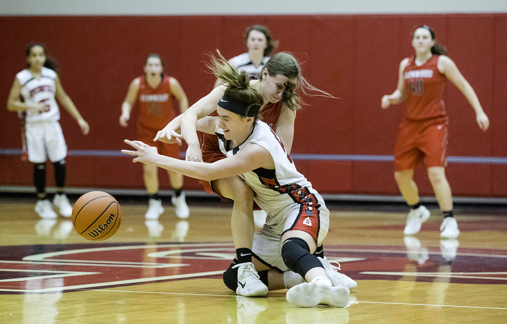 Springfield's Savannah Schoeben collides with Glenwood's Suzie Green during the Class 4A Girls Basketball Regional at Glenwood High School Wednesday,  Feb. 14, 2018. [Ted Schurter/The State Journal-Register]