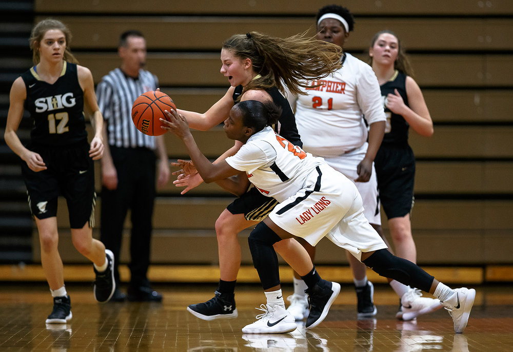 Sacred Heart-Griffin's Sophie Lowis (24) steals the ball away from Lanphier's Martrice Brooks (24) in the second half during the Class 3A Lanphier Regional title game at Lanphier High School, Thursday, Feb. 15, 2018, in Springfield, Ill. [Justin L. Fowler/The State Journal-Register]