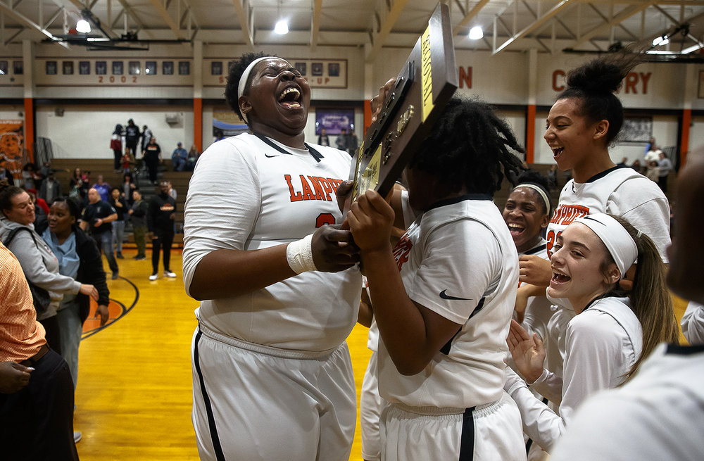 Lanphier's Blessing Casey (21) celebrates with Lanphier's Kiya Holman (1) and the Lions after they defeated Sacred Heart-Griffin 51-36 to win their first regional title since 2006 during the Class 3A Lanphier Regional title game at Lanphier High School, Thursday, Feb. 15, 2018, in Springfield, Ill. [Justin L. Fowler/The State Journal-Register]