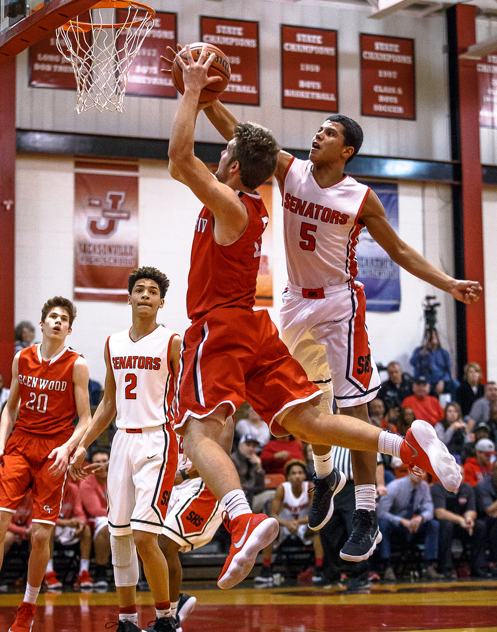 Springfield's Shane Miller (5) blocks a shot from Glenwood's Adam Holm (2) in the first half at Springfield High School, Friday, Feb. 16, 2018, in Springfield, Ill. [Justin L. Fowler/The State Journal-Register]