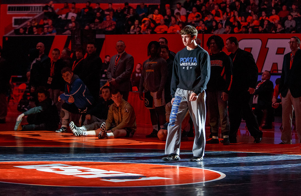 Petersburg PORTA's Trey Hild takes the spotlight during introductions prior to taking on Quincy Notre Dame's Zach Haley in the IHSA Class 1A State Wrestling Tournament 145-pound championship match at the State Farm Center, Saturday, Feb. 17, 2018, in Champaign, Ill. [Justin L. Fowler/The State Journal-Register]