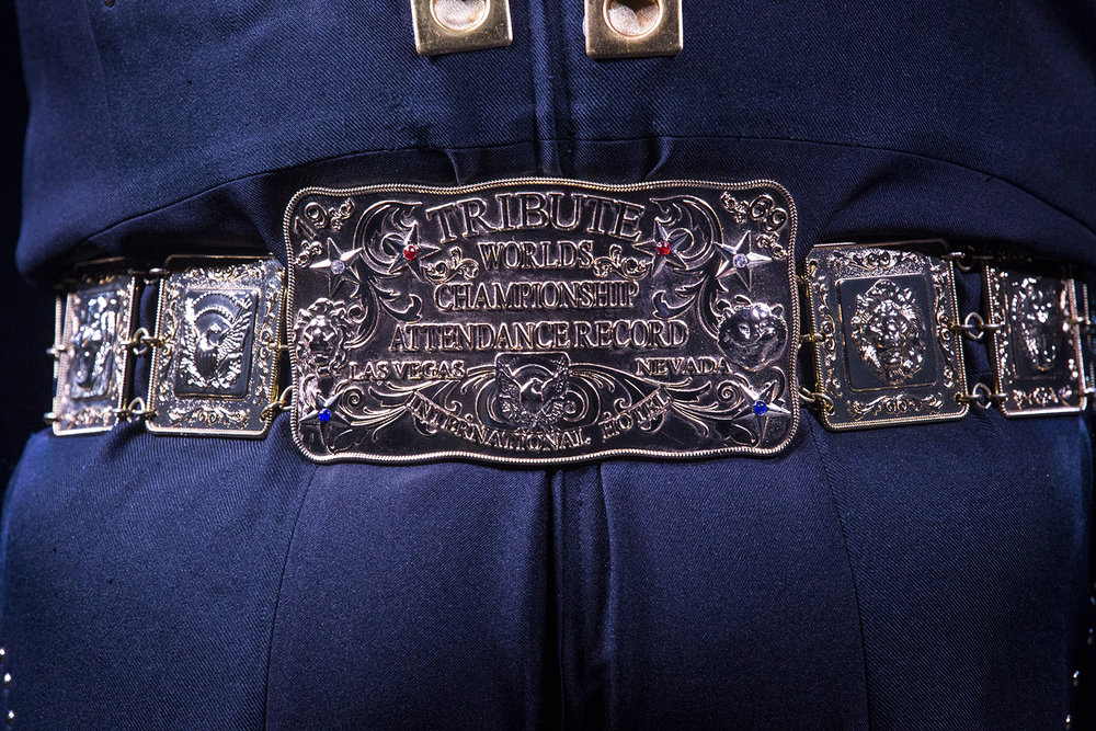Russ Brittain of Ogden, Iowa wears a belt buckle recognizing his attendance record at the Worlds Elvis Tribute Festival in Las Vegas during his performance at the Midwest Tribute to King Friday, Feb. 16, 2018 at the Route 66 Hotel and Conference Center in Springfield, Ill. [Rich Saal/The State Journal-Register]