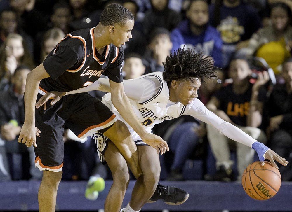 Lanphier's Cardell McGee pressures Southeast's Terrion Murdix at Southeast High School Tuesday,  Feb. 20, 2018. [Ted Schurter/The State Journal-Register]