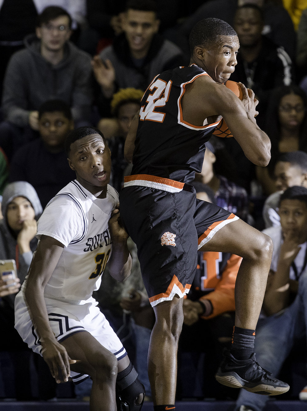 Lanphier's Karl Wright  grasa  rebound in front of Southeast's Devin Blue-Robinson at Southeast High School Tuesday,  Feb. 20, 2018. [Ted Schurter/The State Journal-Register]