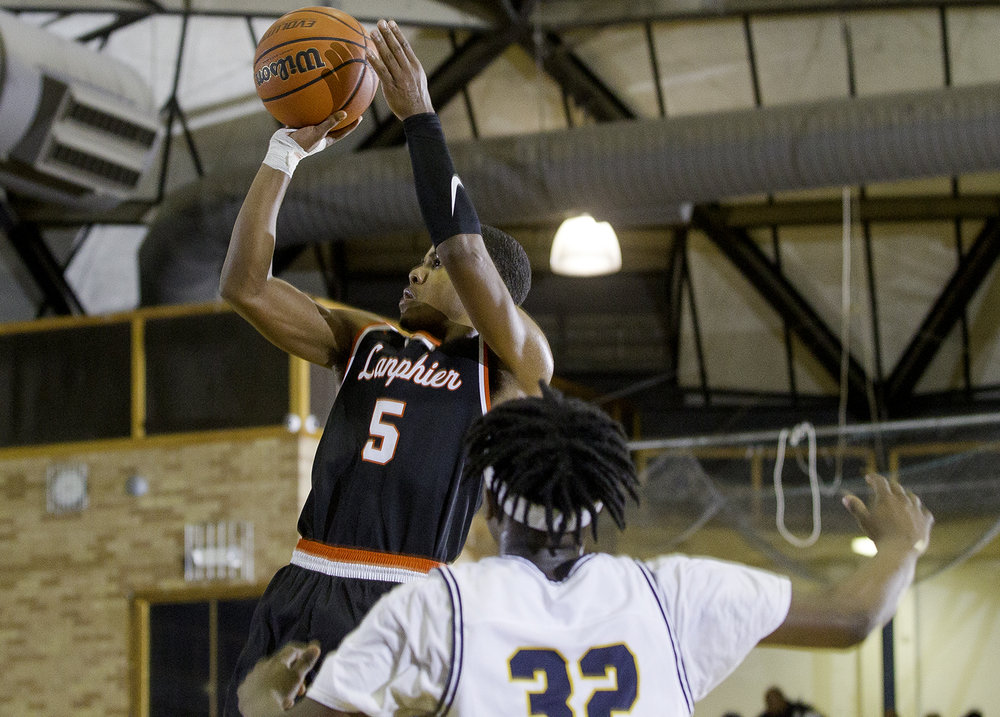 Lanphier's Stanley Morgan  takes a shot in front of Southeast's Stephens Sims at Southeast High School Tuesday,  Feb. 20, 2018. [Ted Schurter/The State Journal-Register]