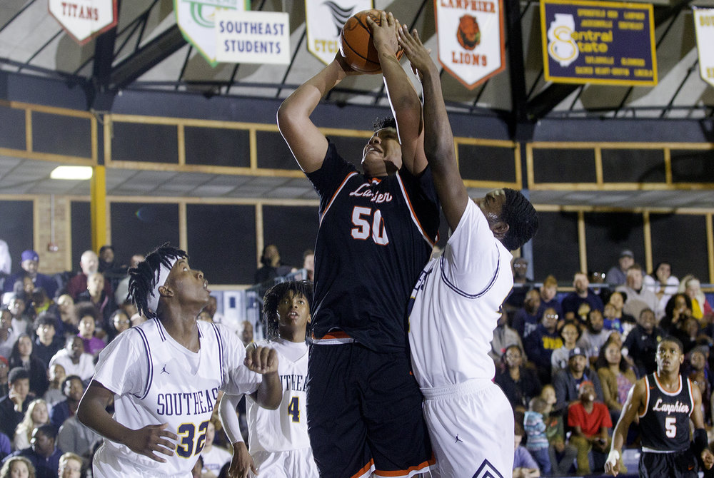 Lanphier's Herb McMath goes up for a shot against Southeast at Southeast High School Tuesday,  Feb. 20, 2018. [Ted Schurter/The State Journal-Register]