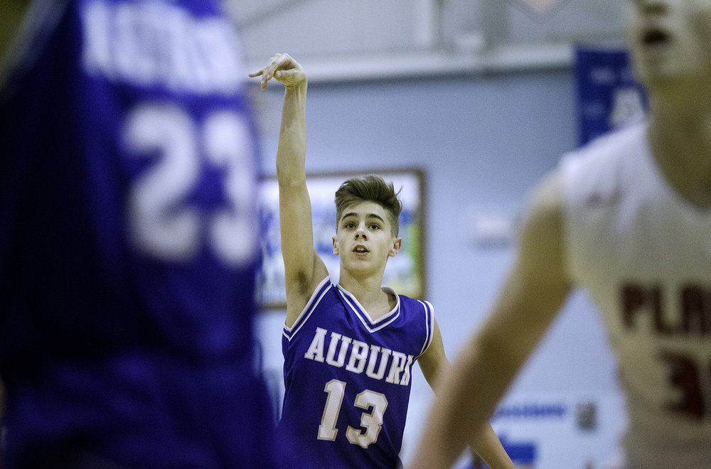 Auburn's Payton Krager watches his three pointer drop against Pleasant Plains during the Class 2A Auburn Regional at Auburn High School Wednesday,  Feb. 21, 2018. [Ted Schurter/The State Journal-Register]