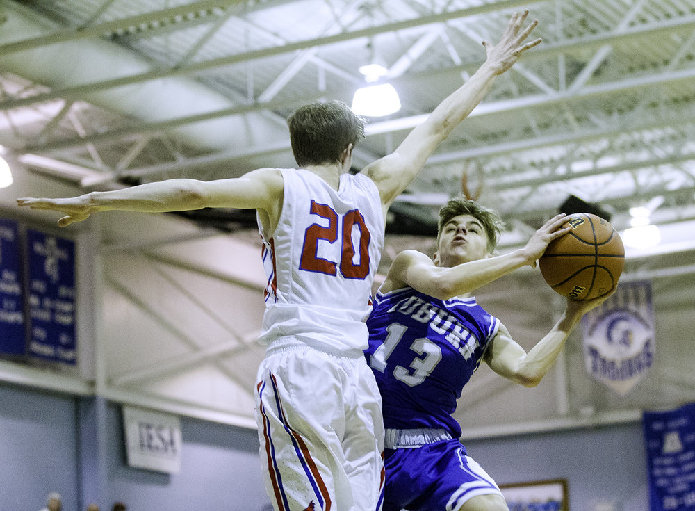 Auburn's Payton Krager bends around Pleasant Plains' Nick Savage as he drives to the hoop during the Class 2A Auburn Regional at Auburn High School Wednesday,  Feb. 21, 2018. [Ted Schurter/The State Journal-Register]