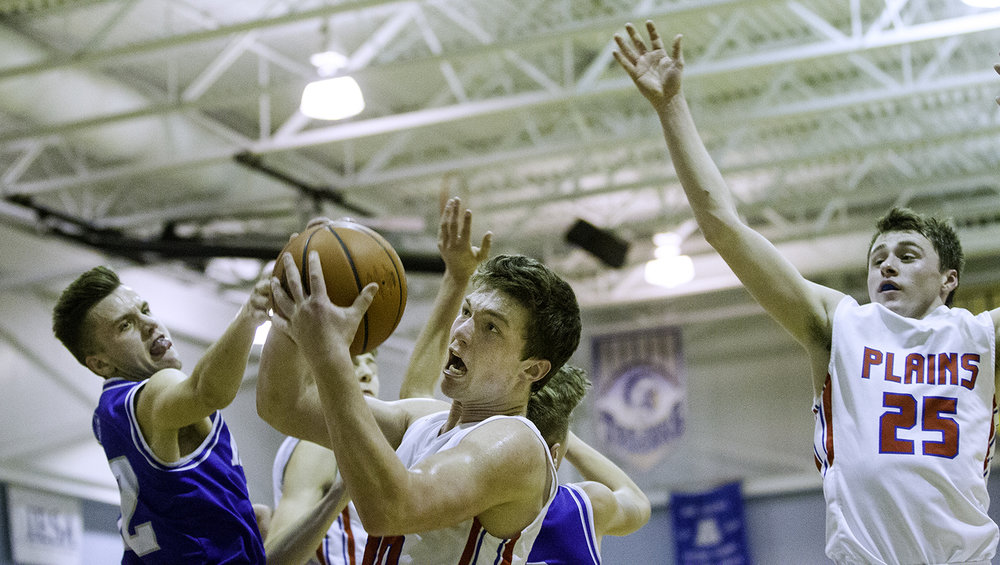 Pleasant Plains' Joel Niermann grabs a rebound in front of Auburn's Colby Bossmann during the Class 2A Auburn Regional at Auburn High School Wednesday,  Feb. 21, 2018. [Ted Schurter/The State Journal-Register]