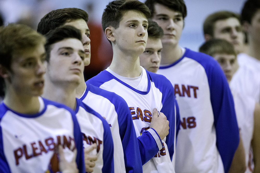 The Pleasant Plains Cardinals stand for the national anthem before facing Auburn during the Class 2A Auburn Regional at Auburn High School Wednesday,  Feb. 21, 2018. [Ted Schurter/The State Journal-Register]