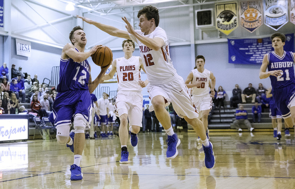 Pleasant Plains' TJ Painter pressures Auburn's Colby Bossmann as he drives to the hoop during the Class 2A Auburn Regional at Auburn High School Wednesday,  Feb. 21, 2018. [Ted Schurter/The State Journal-Register]
