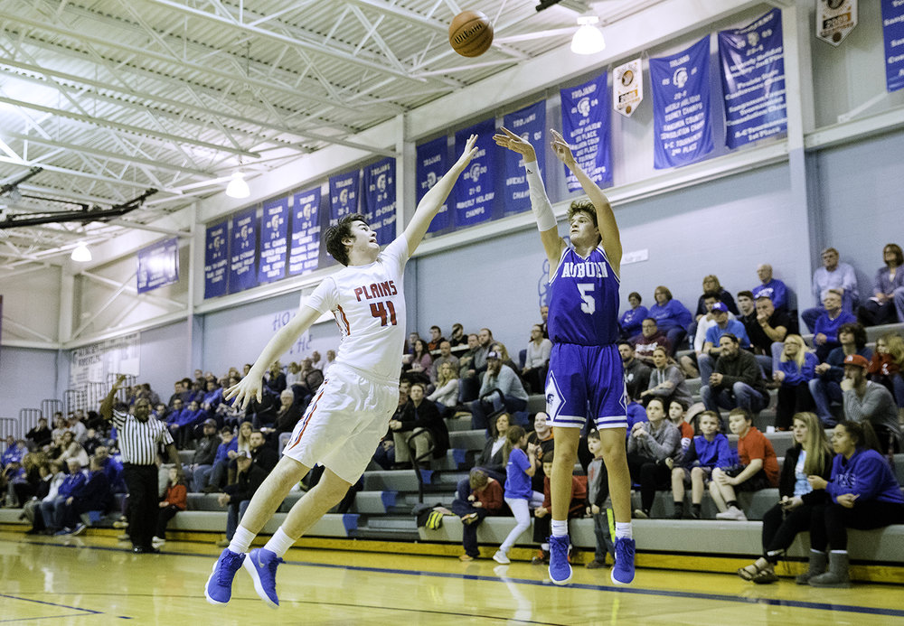 Auburn's Benji Eaker fires a three in front of Pleasant Plains' Chase Schmitt during the Class 2A Auburn Regional at Auburn High School Wednesday,  Feb. 21, 2018. [Ted Schurter/The State Journal-Register]