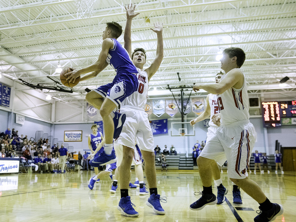 Auburn's Payton Krager flies to the hoop in front of Pleasant Plains' Joel Niermann during the Class 2A Auburn Regional at Auburn High School Wednesday,  Feb. 21, 2018. [Ted Schurter/The State Journal-Register]