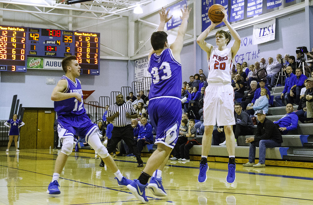 Pleasant Plains' Nick Savage launches a three against Auburn during the Class 2A Auburn Regional at Auburn High School Wednesday,  Feb. 21, 2018. [Ted Schurter/The State Journal-Register]