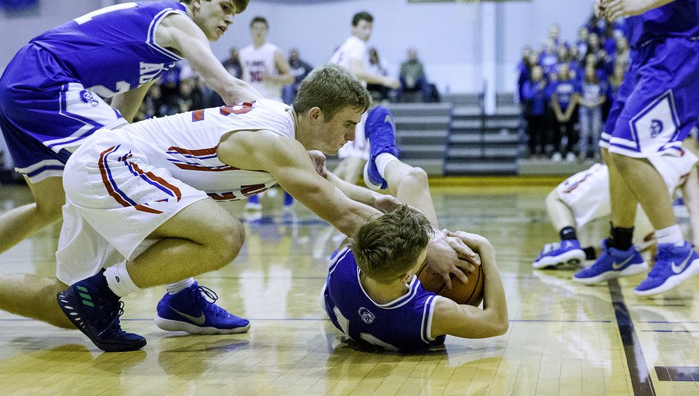 Pleasant Plains' Tristen Tewes dives onto Auburn's Payton Krager as he recovers a loose ball during the Class 2A Auburn Regional at Auburn High School Wednesday,  Feb. 21, 2018. [Ted Schurter/The State Journal-Register]