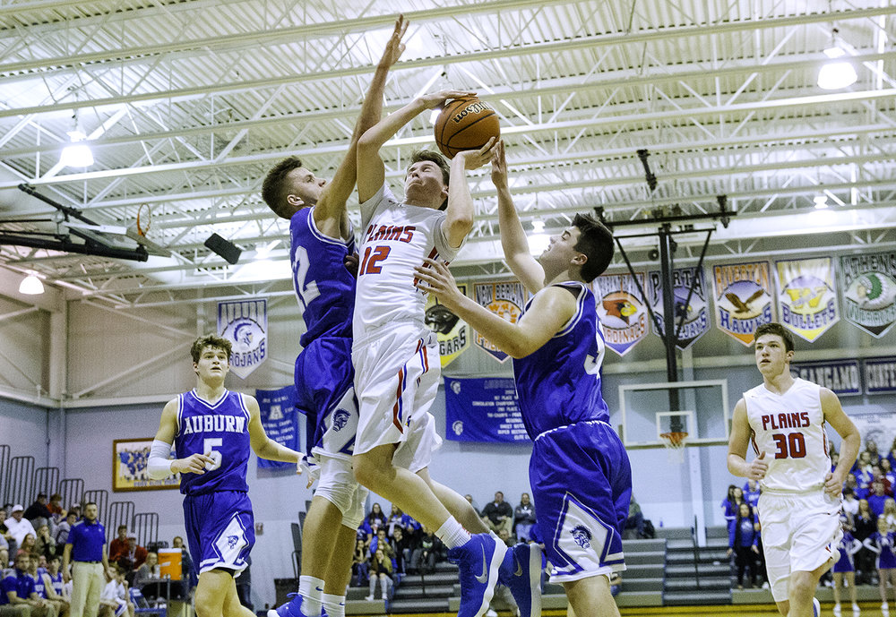 Pleasant Plains' TJ Painter is fouled by Auburn's Colby Bossmann as he drives the lane during the Class 2A Auburn Regional at Auburn High School Wednesday,  Feb. 21, 2018. [Ted Schurter/The State Journal-Register]