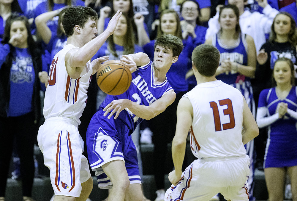 Auburn's Destin Chance gets a pass out under pressure from Pleasant Plains' Joel Niermann during the Class 2A Auburn Regional at Auburn High School Wednesday,  Feb. 21, 2018. [Ted Schurter/The State Journal-Register]