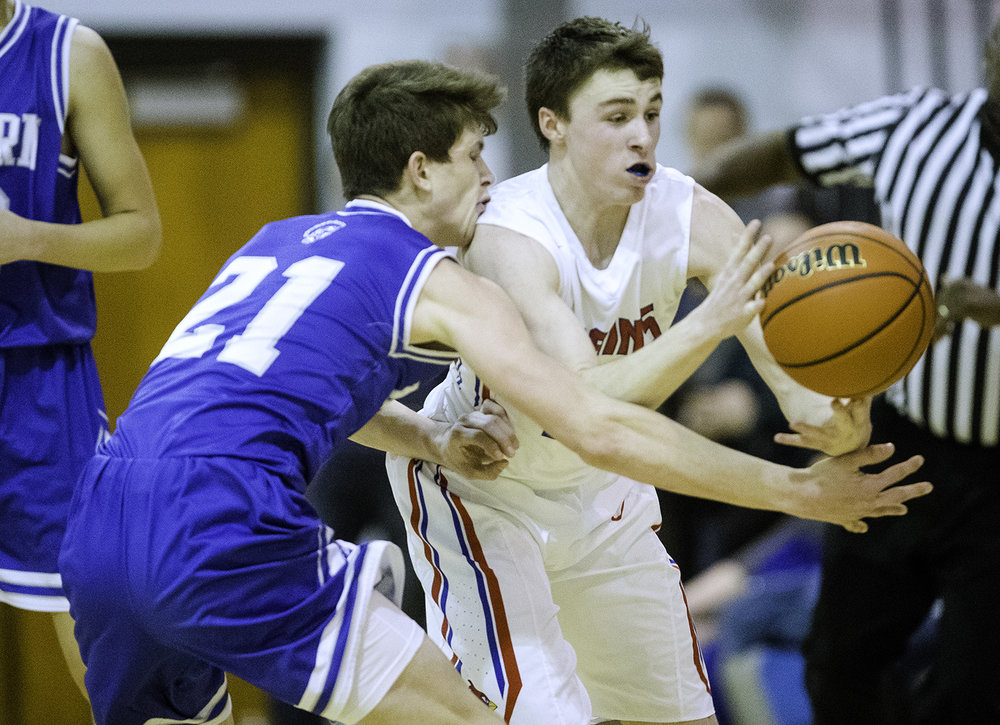 Auburn's Destin Chance and Pleasant Plains' Corgan Greer collide as they race for a loose ball during the Class 2A Auburn Regional at Auburn High School Wednesday,  Feb. 21, 2018. [Ted Schurter/The State Journal-Register]