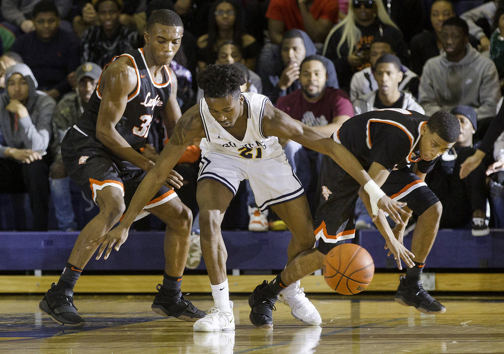 Southeast's Anthony Fairlee and Lanphier's Larry Hemingway race for a loose ball at Southeast High School Tuesday,  Feb. 20, 2018. [Ted Schurter/The State Journal-Register]