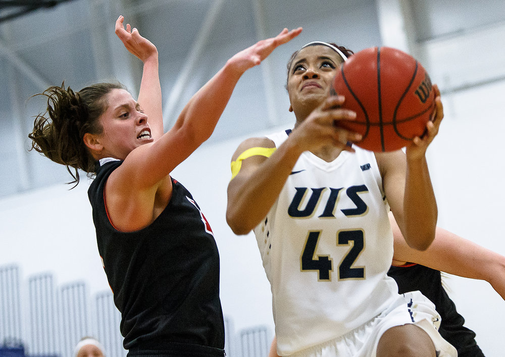 University of Illinois Springfield's Destiny Ramsey (42) drives up to the basket against University of University of Maryville's Amanda Ponce (5) in the second half at UIS' TRAC facility, Thursday, Feb. 22, 2018, in Springfield, Ill. [Justin L. Fowler/The State Journal-Register]