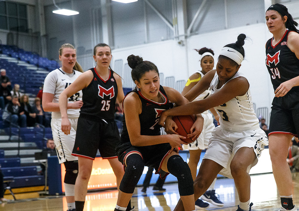 University of Illinois Springfield's Tehya Fortune (3) comes in to force a jump ball against University of Maryville's Mary Barton (2) in the second half at UIS' TRAC facility, Thursday, Feb. 22, 2018, in Springfield, Ill. [Justin L. Fowler/The State Journal-Register]