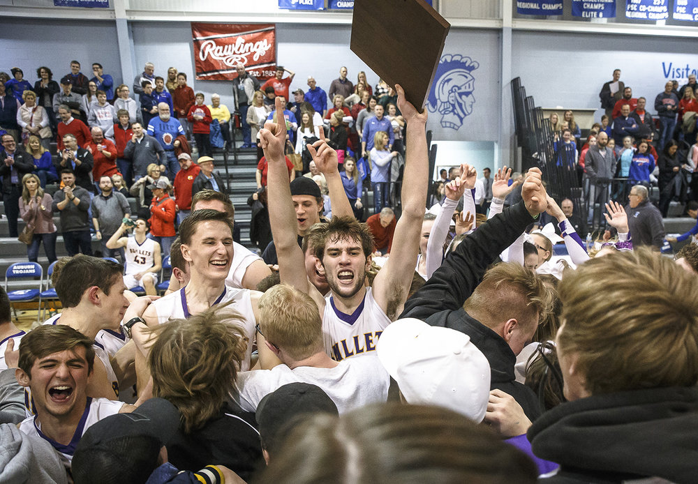 Williamsville's Joseph Mitchell (13) and the Bullets are surrounded by the student section as they rush the court to celebrate the Bullets 63-55 victory over Pleasant Plains in the Class 2A Auburn Regional title game at Auburn High School, Friday, Feb. 23, 2018, in Auburn, Ill. [Justin L. Fowler/The State Journal-Register]