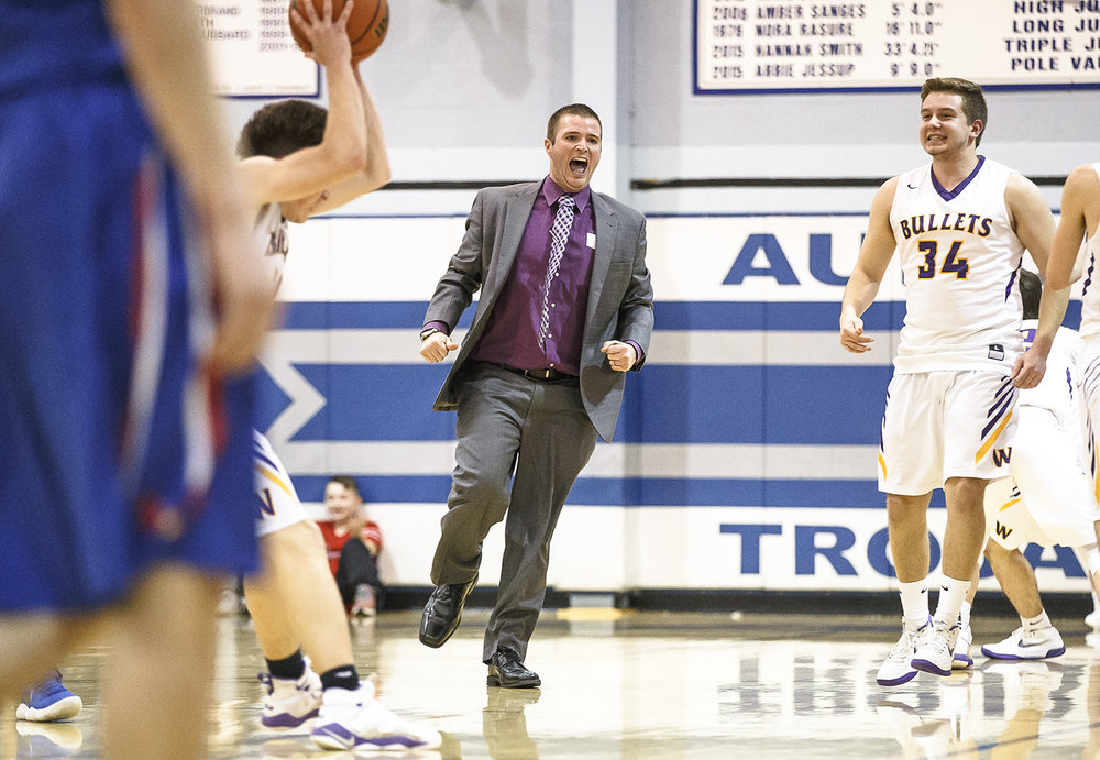 Williamsville boys basketball head coach Nick Beard celebrates the Bullets 63-55 victory over Pleasant Plains in the Class 2A Auburn Regional title game at Auburn High School, Friday, Feb. 23, 2018, in Auburn, Ill. [Justin L. Fowler/The State Journal-Register]