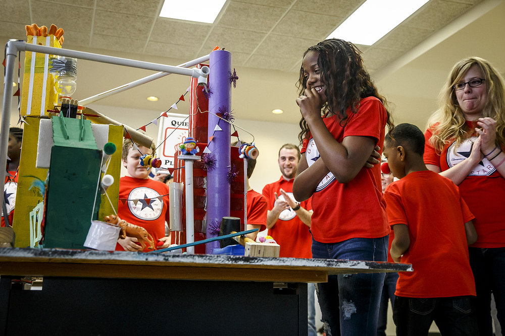 Graham Elementary fifth grader Antonique Wallace watches as a circus themed Rube Goldberg machine she and her classmates built completes it's required task of making an object orbit three times during the 12th annual Springfield Area Fifth Grade Rube Goldberg Competition at Menard Hall on the campus of Lincoln Land Community College, Saturday, Feb. 24, 2018, in Springfield, Ill. [Justin L. Fowler/The State Journal-Register]