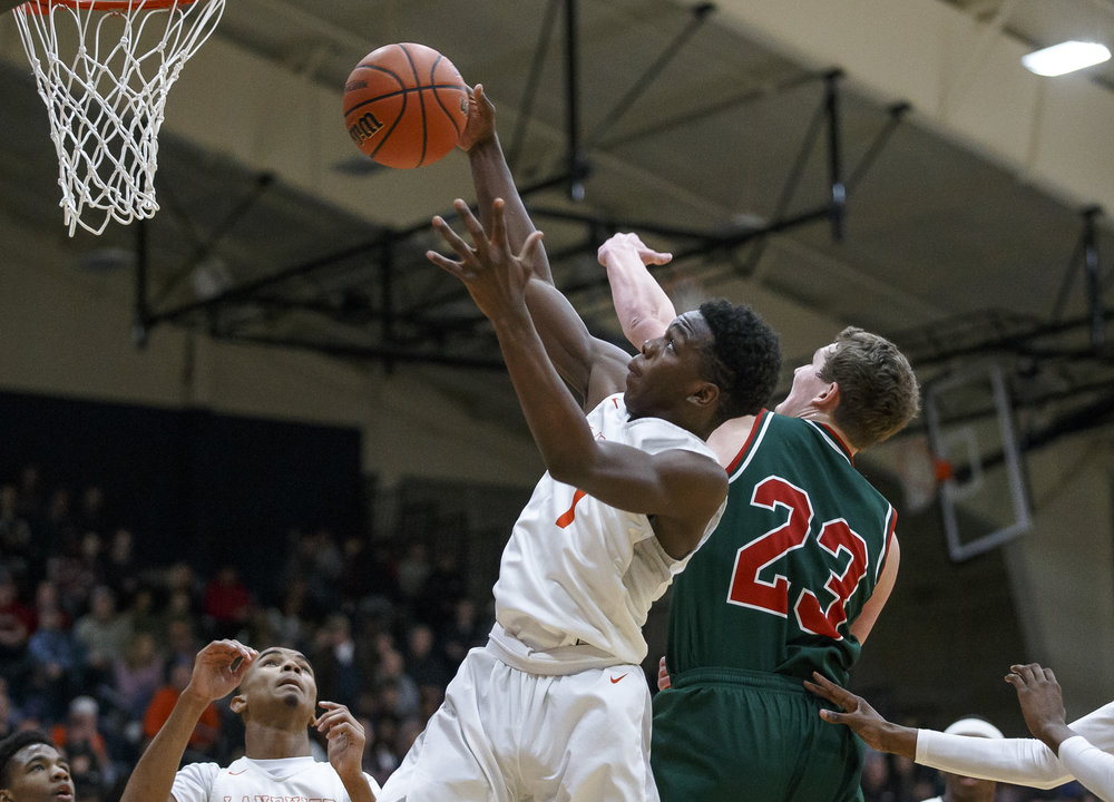 Lanphier's P.J. Edwards (1) wins a rebound over Lincoln's Drew Bacon (23) in the first half of the Class 3A Rochester Regional title game at the Rochester Athletic Complex, Friday, March 2, 2018, in Rochester, Ill. [Justin L. Fowler/The State Journal-Register]