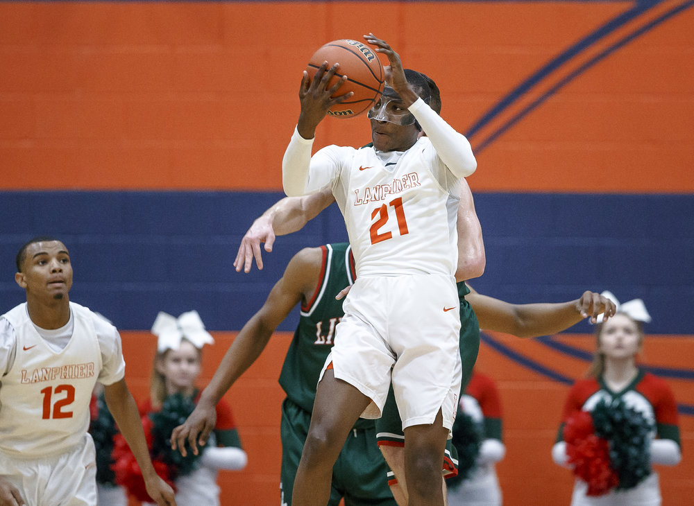 Lanphier's James Jones (21) pulls in a rebound against Lincoln in the second half of the Class 3A Rochester Regional title game at the Rochester Athletic Complex, Friday, March 2, 2018, in Rochester, Ill. [Justin L. Fowler/The State Journal-Register]
