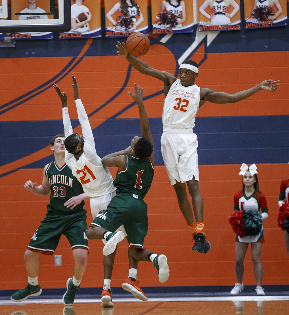 Lanphier's Karl Wright (32) blocks a shot from Lincoln's Titus Cannon (1) in the second half of the Class 3A Rochester Regional title game at the Rochester Athletic Complex, Friday, March 2, 2018, in Rochester, Ill. [Justin L. Fowler/The State Journal-Register]