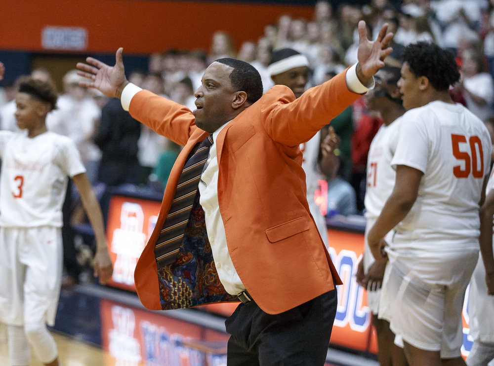 Lanphier boys basketball head coach Blake Turner celebrates the Lions 33-19 in the Class 3A Rochester Regional title game at the Rochester Athletic Complex, Friday, March 2, 2018, in Rochester, Ill. [Justin L. Fowler/The State Journal-Register]