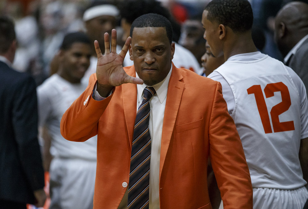 Lanphier boys basketball head coach Blake Turner motions for five straight regional titles for the Lions after they defeated Lincoln 33-19 in the Class 3A Rochester Regional title game at the Rochester Athletic Complex, Friday, March 2, 2018, in Rochester, Ill. [Justin L. Fowler/The State Journal-Register]