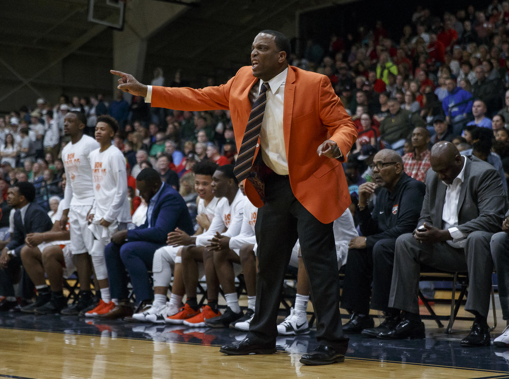 Lanphier boys basketball head coach Blake Turner calls out instructions to the Lions as they take on Lincoln in the second half of the Class 3A Rochester Regional title game at the Rochester Athletic Complex, Friday, March 2, 2018, in Rochester, Ill. [Justin L. Fowler/The State Journal-Register]