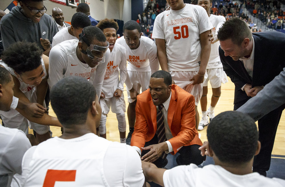 Lanphier boys basketball head coach Blake Turner celebrates with his team as they take a time out leading Lincoln going into the final minute of the game in the Class 3A Rochester Regional title game at the Rochester Athletic Complex, Friday, March 2, 2018, in Rochester, Ill. [Justin L. Fowler/The State Journal-Register]