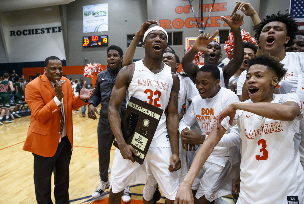 Lanphier's Karl Wright (32) and the Lions celebrate with their fifth straight regional title after defeating Lincoln 33-19 in the Class 3A Rochester Regional title game at the Rochester Athletic Complex, Friday, March 2, 2018, in Rochester, Ill. [Justin L. Fowler/The State Journal-Register]