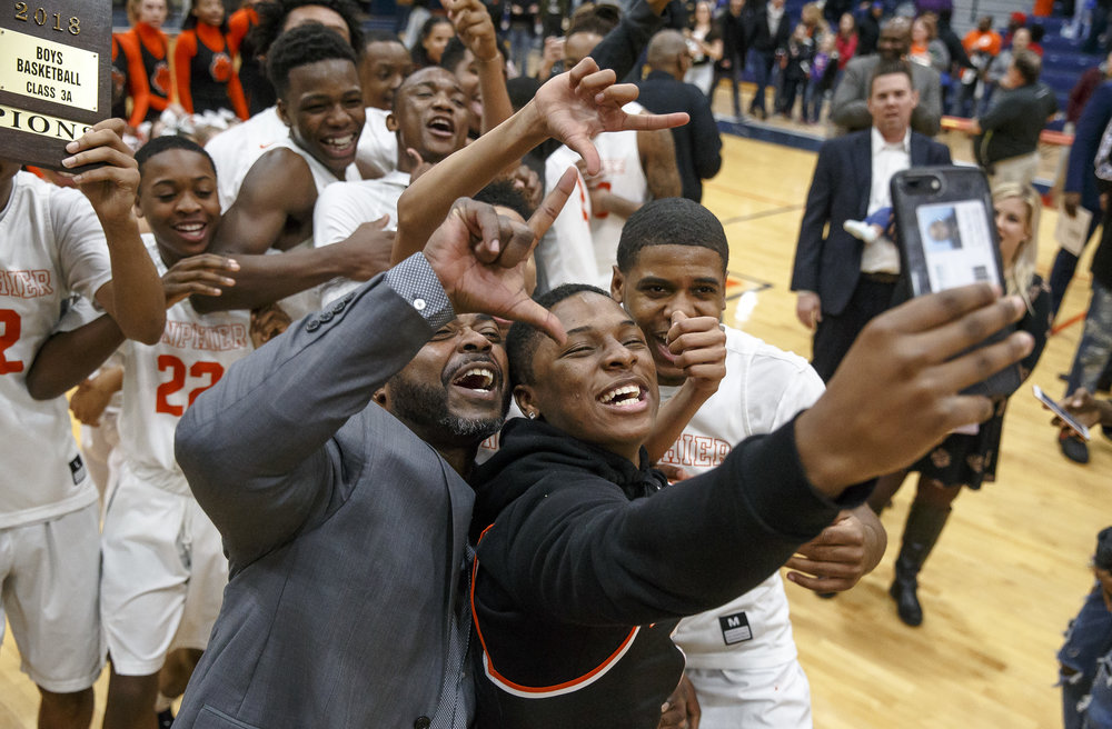 Lanphier graduate Yaakema Rose celebrates with the Lions after they defeated Lincoln 33-19 in the Class 3A Rochester Regional title game at the Rochester Athletic Complex, Friday, March 2, 2018, in Rochester, Ill. [Justin L. Fowler/The State Journal-Register]
