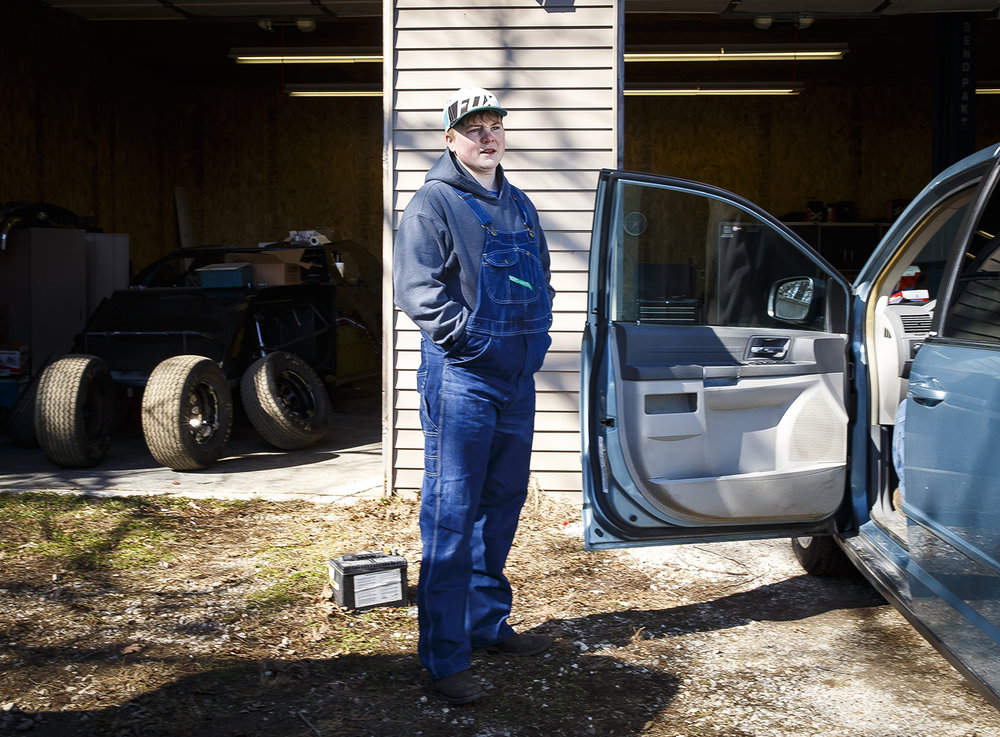 Carter Sinkhorn waits to see what the next task is that he can help his father, James, perform while working for him helping repair cars to earn money, Sunday, Feb. 25, 2018, in Taylorville, Ill. Carter has been on a road to recovery and trying to straighten out his life since New Year's Eve of 2017 when he drove home from a party after drinking 15 beers and wrecked his truck at a high rate of speed. He suffered a broken right leg and right wrist, torn ligaments in his knee, pelvic fractures, numerous breaks in the bones of his face and a brain injury known as a subdural hematoma. [Justin L. Fowler/The State Journal-Register]