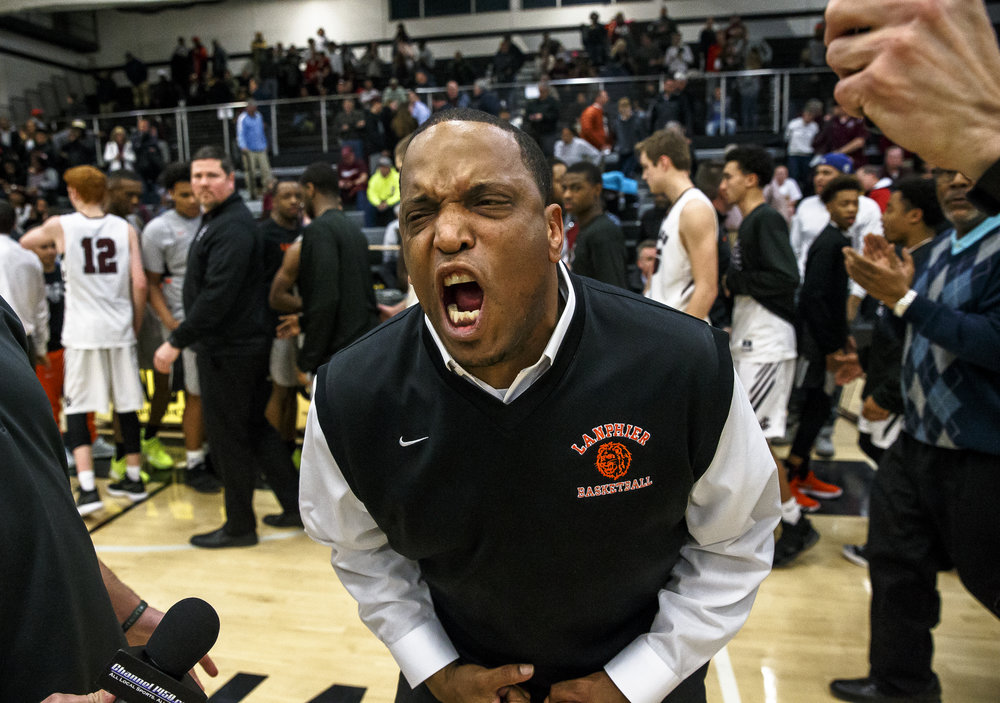 Lanphier boys basketball head coach Blake Turner screams out after the Lions defeated Champaign Central in double overtime in the Class 3A Decatur Eisenhower Sectional semifinals at Eisenhower High School, Tuesday, March 6, 2018, in Decatur, Ill. [Justin L. Fowler/The State Journal-Register]