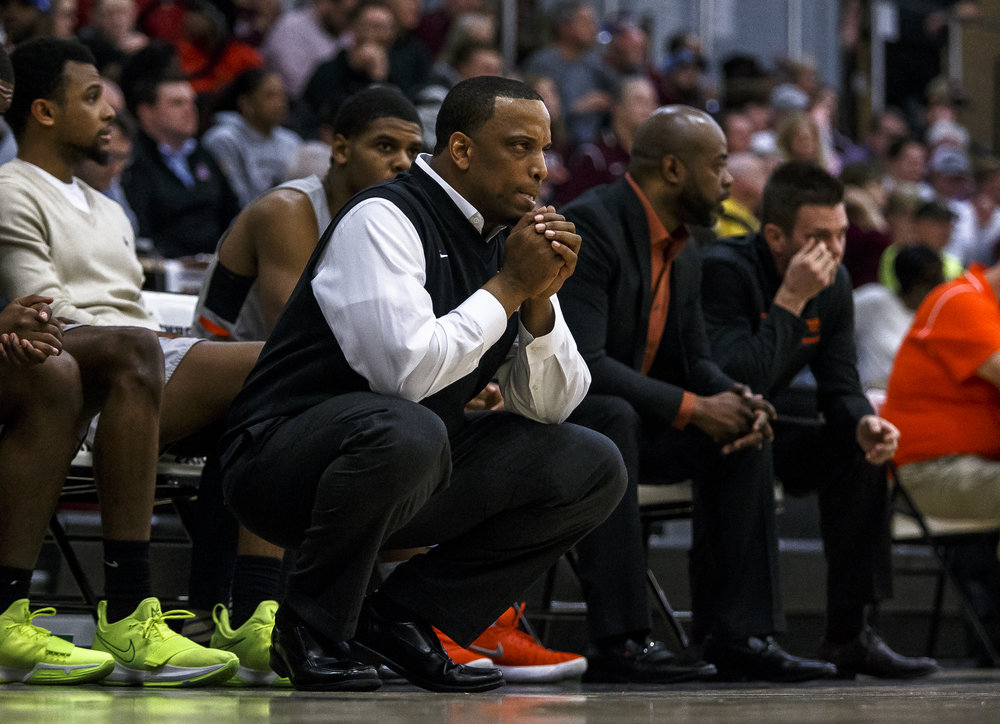 Lanphier boys basketball head coach Blake Turner watches as the Lions trail Champaign Central in the second half during the Class 3A Decatur Eisenhower Sectional semifinals at Eisenhower High School, Tuesday, March 6, 2018, in Decatur, Ill. [Justin L. Fowler/The State Journal-Register]