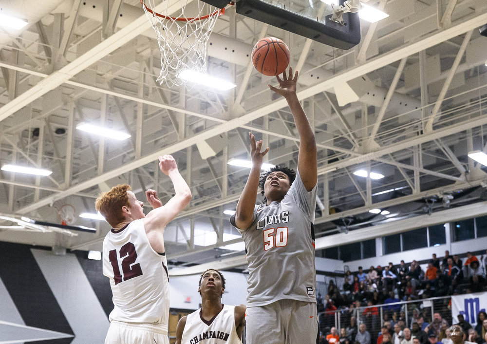 Lanphier's Herb McMath (50) goes up for a basket against Champaign Central's Sam Beesley (12) in the second half during the Class 3A Decatur Eisenhower Sectional semifinals at Eisenhower High School, Tuesday, March 6, 2018, in Decatur, Ill. [Justin L. Fowler/The State Journal-Register]
