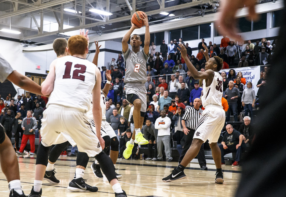 Lanphier's Cardell McGee (12) shoots a jumper against Champaign Central in overtime during the Class 3A Decatur Eisenhower Sectional semifinals at Eisenhower High School, Tuesday, March 6, 2018, in Decatur, Ill. [Justin L. Fowler/The State Journal-Register]