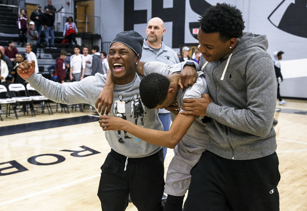 Lanphier graduates Yaakema Rose, left, and Aundrae Williams, right, celebrate the Lions 71-69 victory against Champaign Central with Lanphier's Larry Hemingway (4) in the second half during the Class 3A Decatur Eisenhower Sectional semifinals at Eisenhower High School, Tuesday, March 6, 2018, in Decatur, Ill. [Justin L. Fowler/The State Journal-Register]