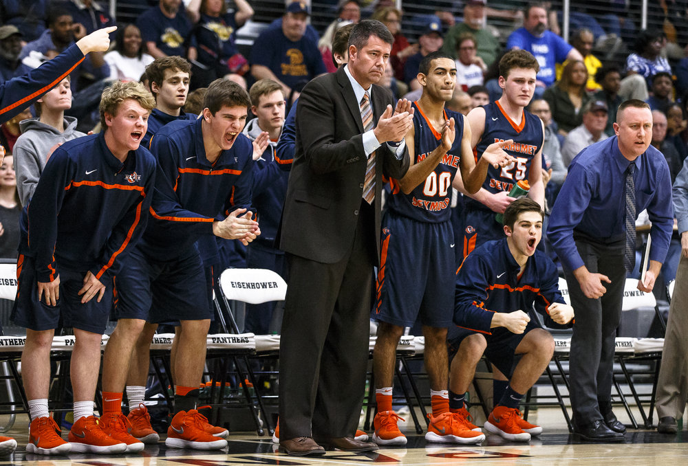 Mahomet-Seymour boys basketball head coach Chad Benedict and the Bulldogs' bench cheer on the team as they force a turnover against Southeast in the first half during the Class 3A Decatur Eisenhower Sectional semifinals at Eisenhower High School, Wednesday, March 7, 2018, in Decatur, Ill. [Justin L. Fowler/The State Journal-Register]