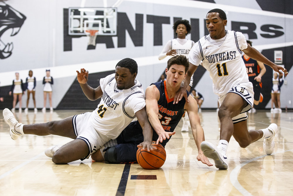 Southeast's Robert Hayes (41) his the floor with Mahomet-Seymour's Brooks Coetzee (23) as they go after the ball in the first half during the Class 3A Decatur Eisenhower Sectional semifinals at Eisenhower High School, Wednesday, March 7, 2018, in Decatur, Ill. [Justin L. Fowler/The State Journal-Register]